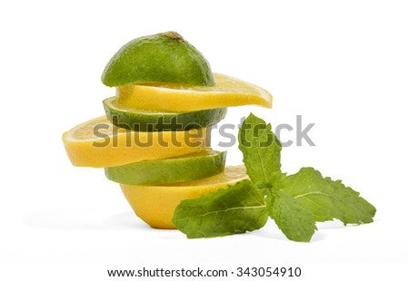 Lemon and lime piled up alternately with some mint leaves