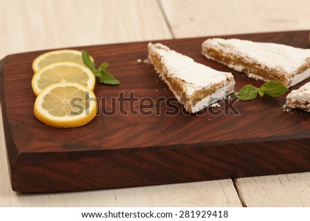 Lemon bars on a unique serving tray - stock photo