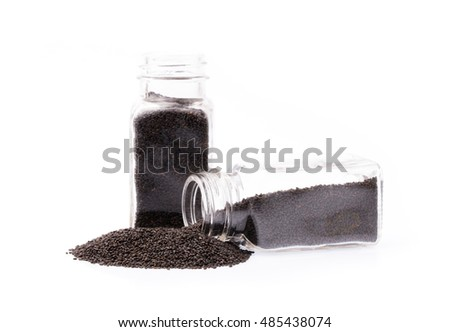 Lemon basil seeds in glass container isolated on the white background