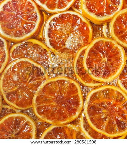 lemon boiled in sirup, lemon slices with sugar sirup - stock photo