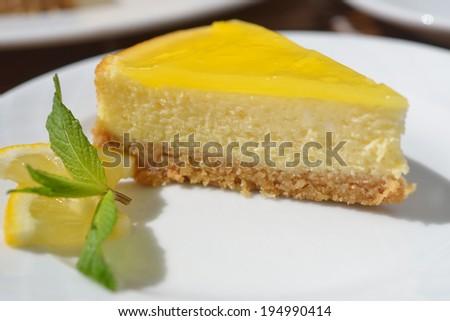 Lemon cheesecake on the plate closeup - stock photo