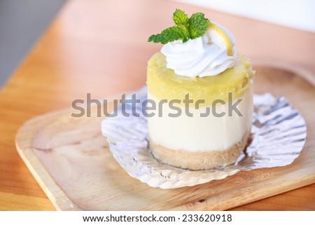 Lemon cheesecake on wood table  - stock photo