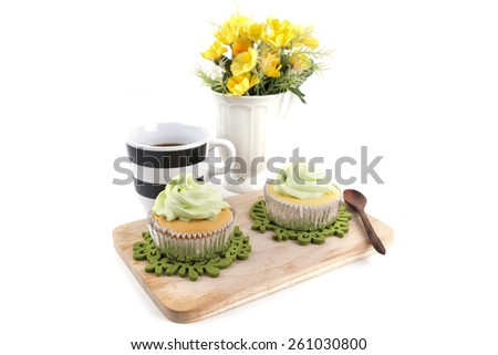 Lemon cup cake  with cup of tea isolated on white - stock photo