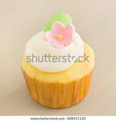 Lemon cupcake on a textured background. - stock photo