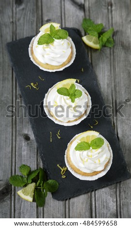 Lemon cupcakes from above on rustic wooden table