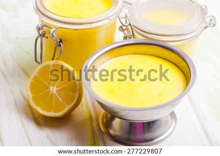 Lemon curd in glass jars on the table