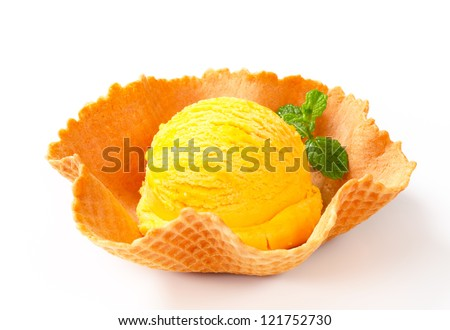 Lemon custard ice cream in a waffle basket  - stock photo