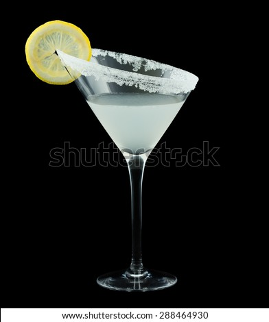 Lemon Drop Martini is a cocktail that contains vodka citron, triple sec, fresh lemon juice and is rimmed with sugar and garnished with a slice of lemon. Isolated on black. - stock photo