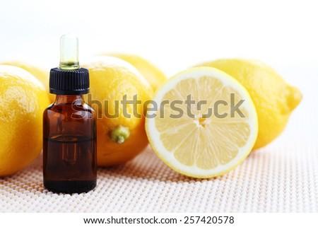 lemon essence oil - beauty treatment - stock photo