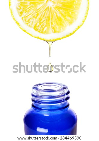 Lemon essence. Refreshing aromatherapy. Alternative medicine. - stock photo