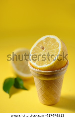 Lemon fruit in ice cream cone with lemon slices