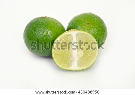 Lemon fruit (Other names are lime in French, citrus fruit, lime green, Key lime, Persian lime, Kaffir lime, desert lime) with half cross section isolated on white