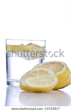 Lemon fruits with glass isolated on white