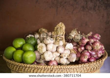 Lemon, garlic and red onion bunch - stock photo