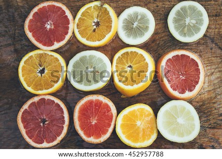 lemon, grapefruit, orange on wooden table