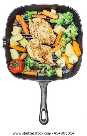 Lemon grilled chicken breast with fried vegetables in pan on white background - stock photo