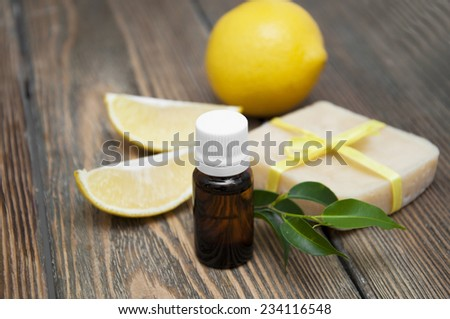 Lemon handmade soap with essential oils and lemon on a wooden background - stock photo