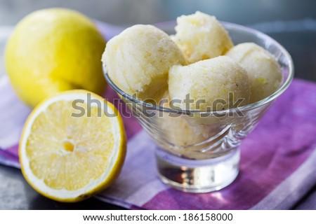 Lemon ice cream sorbet, balls in glass, refreshing summer diet dessert - stock photo