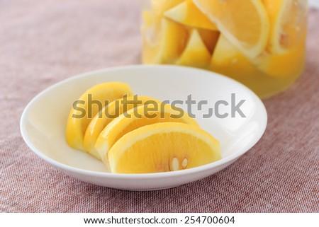 Lemon in salt for seasoning - stock photo