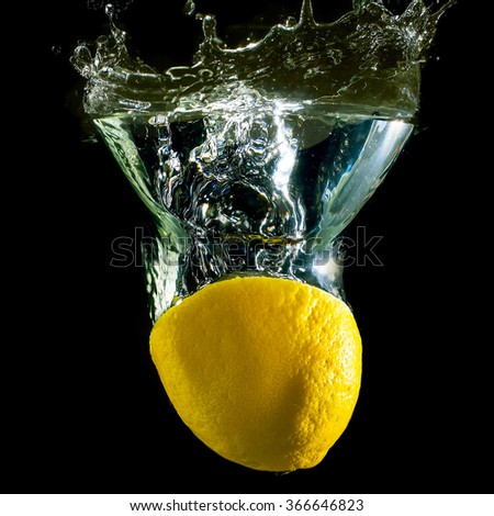 Lemon in the bubbles on a black background