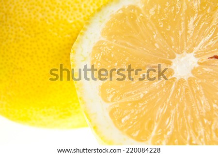 Lemon - isolated ripe fruit against white background with a little twig