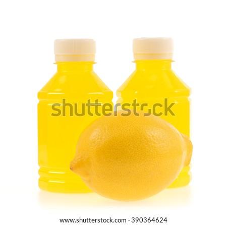 Lemon juice in plastic bottle isolated on white background - stock photo