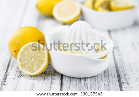 Lemon Juice on a vintage background as detailed close-up shot (selective focus)