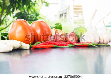 lemon, lemon grass, red chilli, and kaffir lime leaves on background. selective focus - stock photo