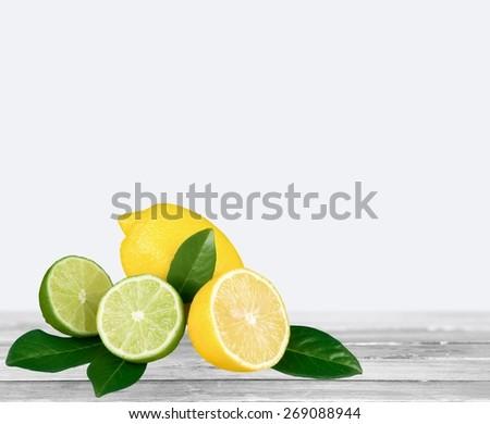 Lemon. Lemon Lime + Leafs - stock photo