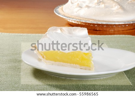 lemon meringue pie on green placemat - stock photo