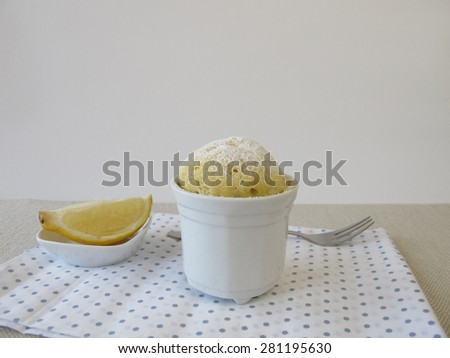 Lemon mug cake from microwave - stock photo
