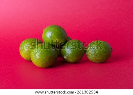 Lemon, orange, lime on a color background - stock photo