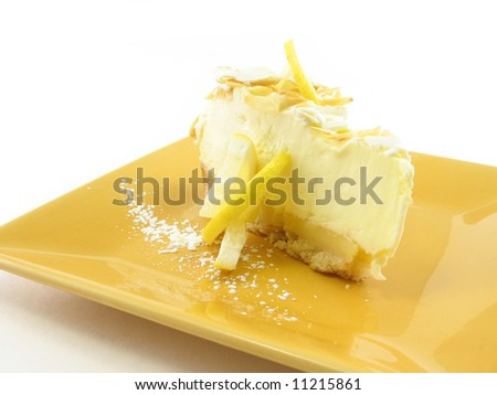 Lemon pie on a yellow plate isolated on white - stock photo