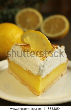 Lemon pie with meringue on a wooden table - stock photo