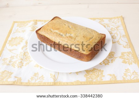 Lemon Poppy Seed Bread on a White Plate