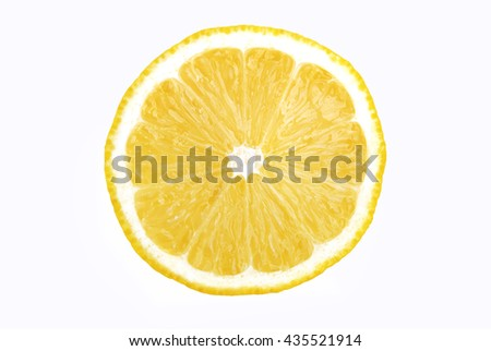 Lemon slice in a cut on a white background. - stock photo