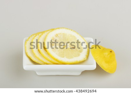 Lemon sliced in a rectangular white plate