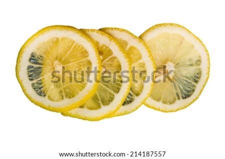 Lemon slices stacked and isolated on white