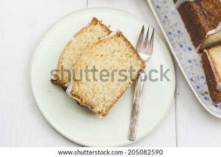 Lemon sponge cake served on plate - stock photo