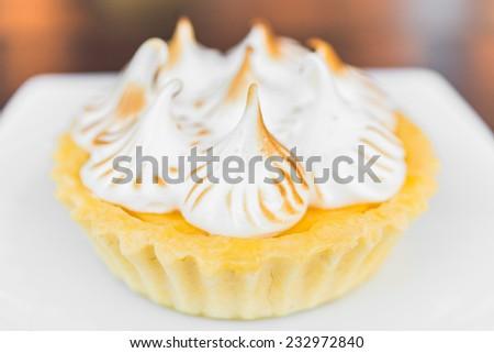 Lemon tart cakes in white plate - stock photo