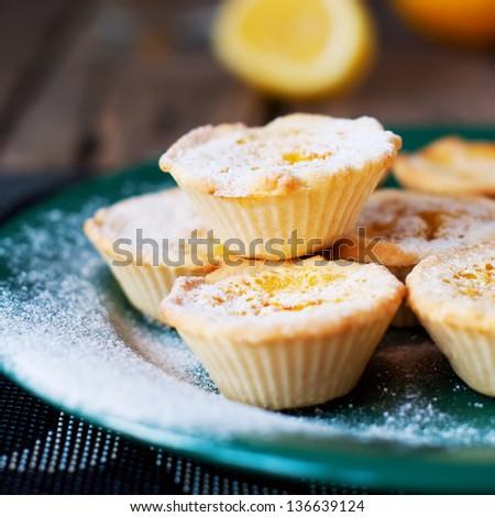 Lemon Tartlets with Powdered sugar - stock photo