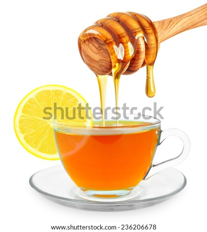 lemon tea with honey in a glass on a white background  - stock photo