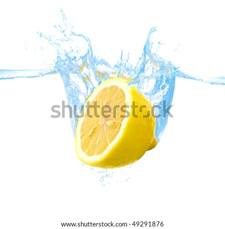 lemon thrown into the water with splash