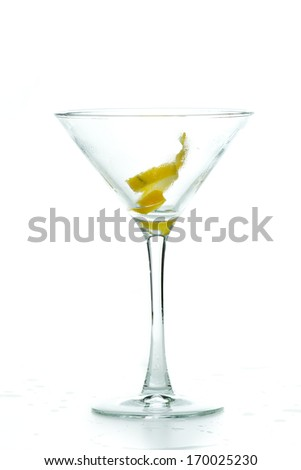 lemon twist in a chilled martini glass isolated on a white background