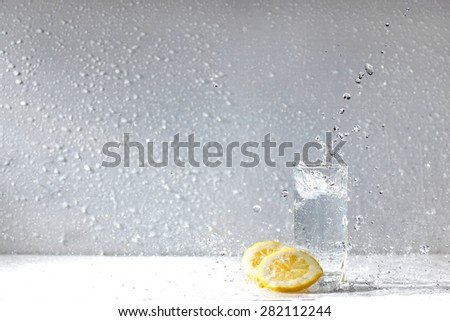 Lemon water drops fresh citrus yellow freshness - stock photo