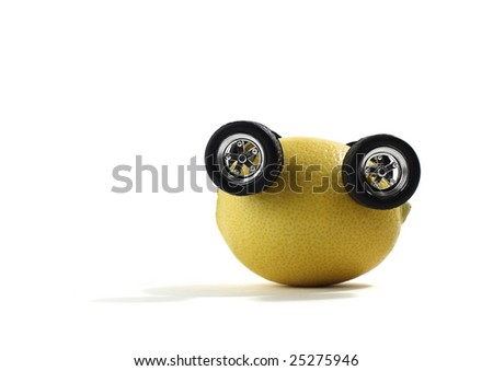 Lemon with Automobile Wheels Upside down - stock photo