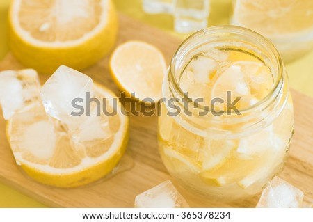 Lemonade in a glass jar and ice cubes