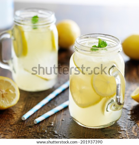 lemonade in jar with ice and mint - stock photo