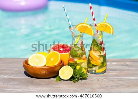 lemonade in jar with orange and grapefruit on wooden table