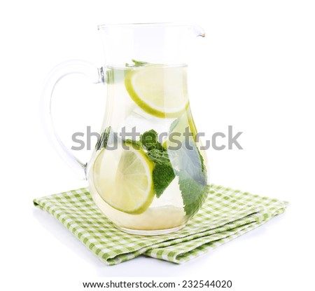 Lemonade in pitcher isolated on white - stock photo